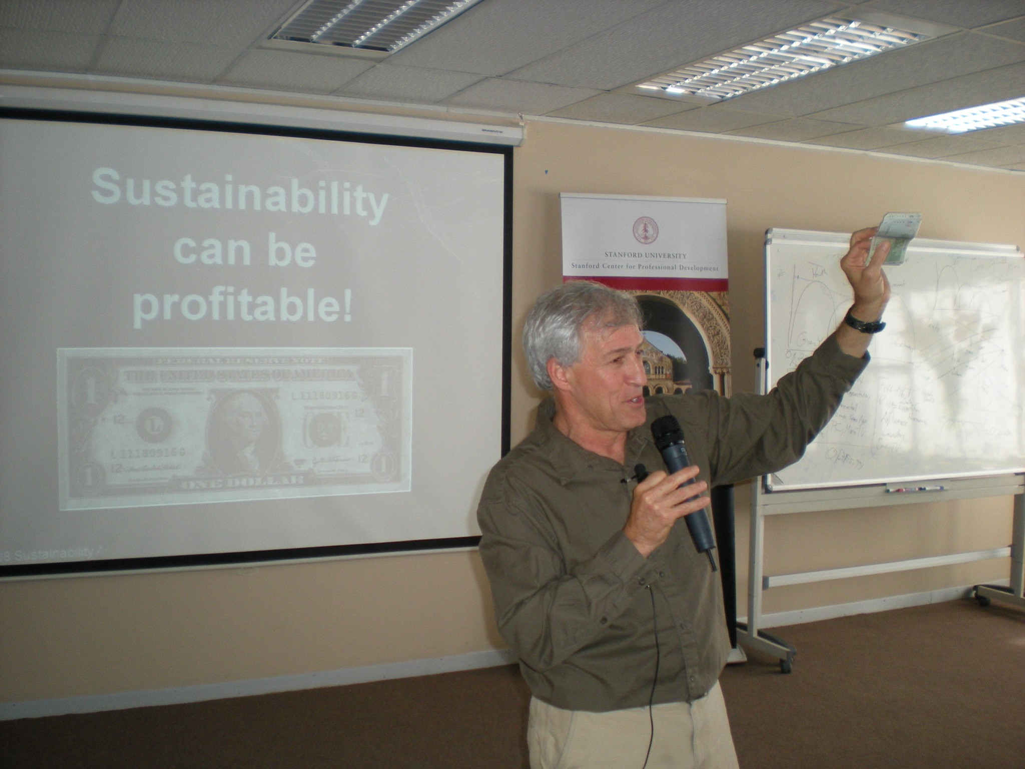 """Terry Gips giving a presentation titled """"Sustainability can be profitable!"""""""