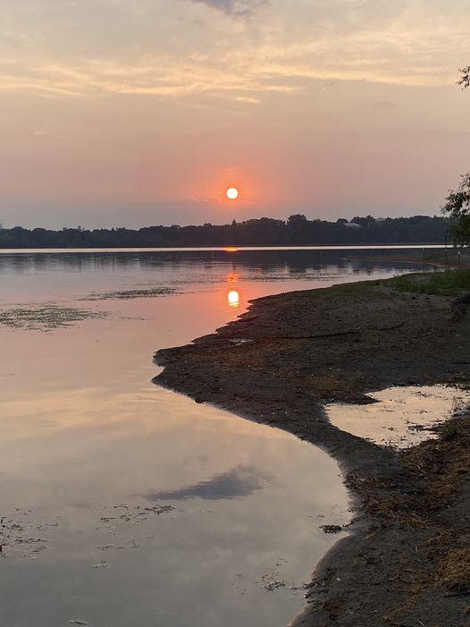 Photo of a sunrise over a lake