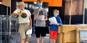 """Terry Gips and two of his songs at their state fair presentation: """"Raising Kids Sustainably: Having a Fund, Healthy Planet While Saving Money"""