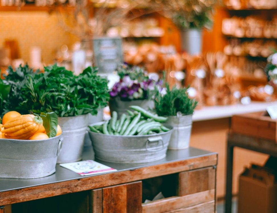 Various fresh vegetables and natural products in a small shop.